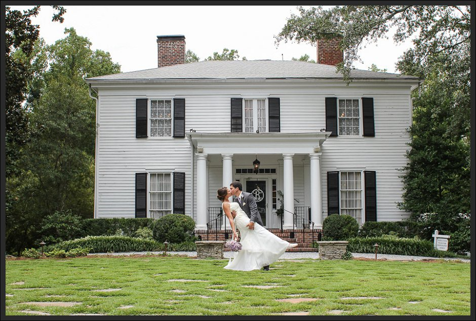 Eric dips his bride and gives her a romantic kiss out front of charming wedding venue, Primrose Cottage